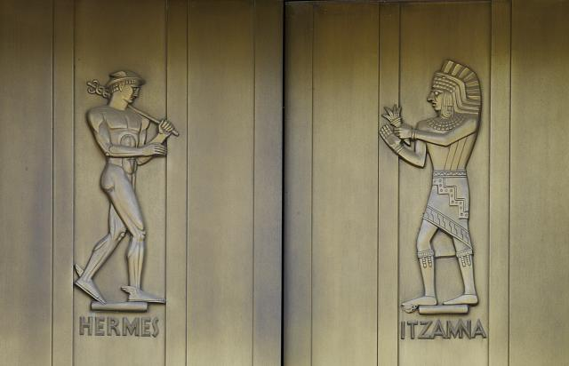 [Exterior view. Door detail, east entrance. Hermes and Itzama, sculpted bronze figures by Lee Lawrie. Library of Congress John Adams Building, Washington, D.C.]
