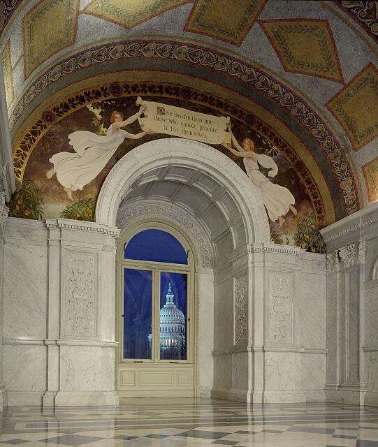"[North Corridor, Great Hall. View of the U.S. Capitol at sunrise, seen through a window below a mural by Charles Sprague Pearce that shows female figures with quotation from Confucious that begins ""Give instruction ...."" Library of Congress Thomas Jefferson Building, Washington, D.C.]"