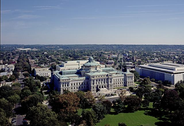: [Aerial view showing the Library of Congress Thomas Jefferson Building, with East Capitol Street on the left and the James Madison Building on the right, Washington, D.C.]