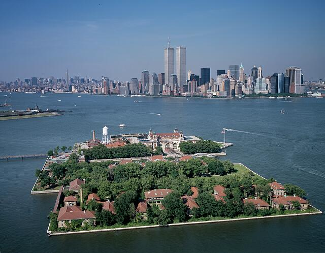 Aerial view of Ellis Island with New York City World Trade Center in the background taken in July 2001