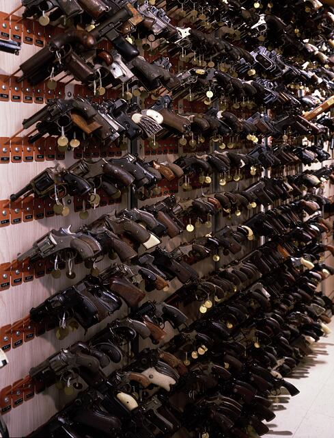 Confiscated guns on a display at the F.B.I. Headquarters, Washington, D.C.