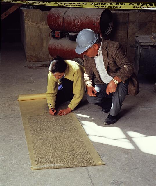 John Barianos, right, teaches an artisan how to draw the pattern of a mosaic floor in the Willard Hotel, Washington, D.C., during the 1980s restoration