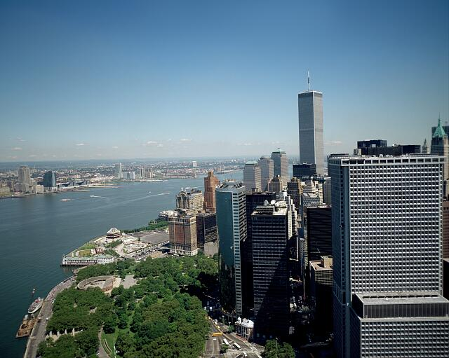 Aerial view of New York City, in which one the World Trade Center twin towers can be seen