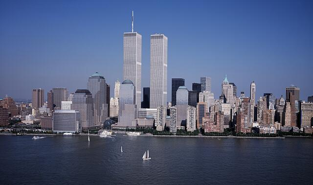 Aerial view of New York City, in which the World Trade Center Twin Towers is prominent