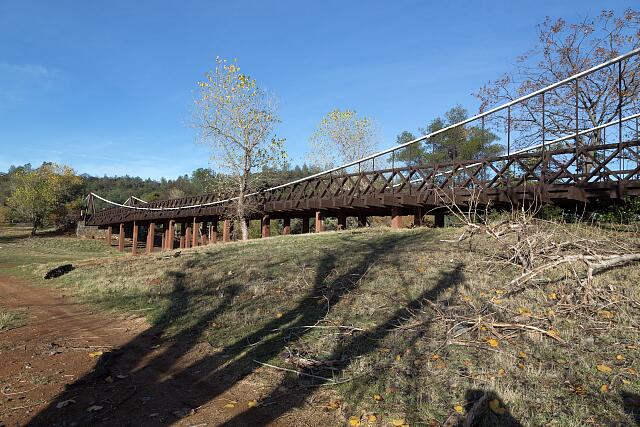 The original Bidwell Bar Bridge over Lake Oroville, a manmade reservoir created by the damming of the Feather River above Oroville, California