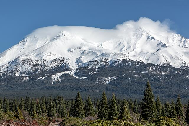 Distant views of looming Mount Shasta, located at the southern end of the Cascade Range in Siskiyou County, California