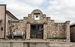 A mission-like building made of vernacular Texas stone in Rio Grande City, Texas, in Starr County