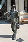 """Quittin' time,"" the statue of an oil worker heading home for the day, was placed on a downtown street in Corsicana, Texas, in 2012"