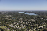 Aerial view of Geist Reservoir and surrounding housing developments in Indianapolis suburb of Fishers, Indiana