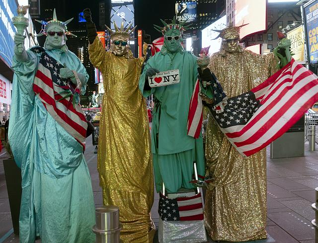 Mimes dress as Lady Liberty (the figure on the Statue of Liberty) in downtown Manhattan (borough) in New York City