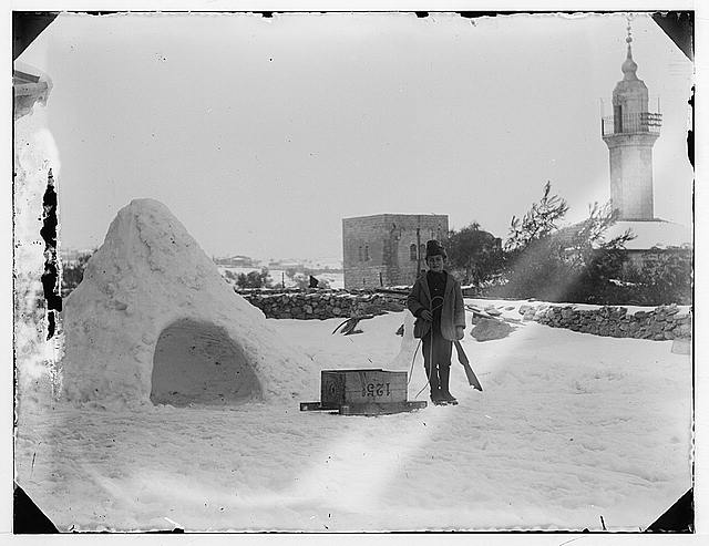 Snow in Jerusalem, 1921. Man with box on sled