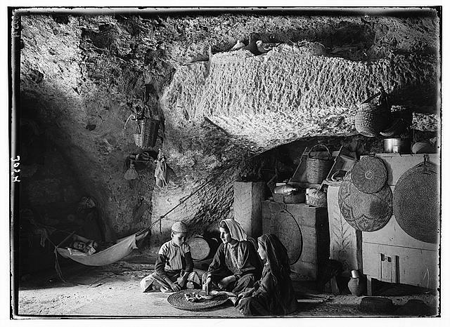 Bethlehem and surroundings. Bethlehem. A manger home. Room, part cave. Swaddled baby & dove-cote