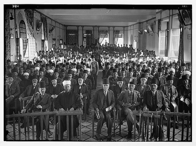 "Arab protest delegations, demonstrations and strikes against British policy in Palestine (subsequent to the foregoing disturbances [1929 riots]). An Arab ""protest gathering"" in session. In the Rawdat el Maaref hall"
