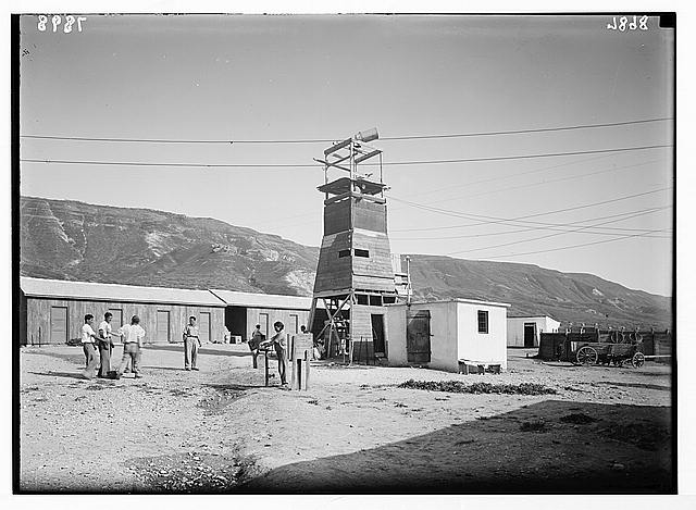 Ain Geb. Jewish settlement on east side of S. Gal. [i.e., Sea of Galilee]. Scene inside the settlement showing look-out tower with mounted searchlight