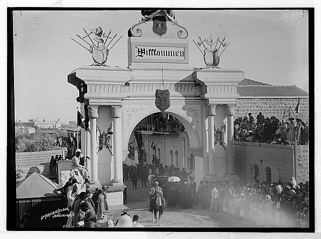 "State visit to Jerusalem of Wilhelm II of Germany in 1898. Large crowd waiting at ""Willkommen"" arch for Emperor's arrival."