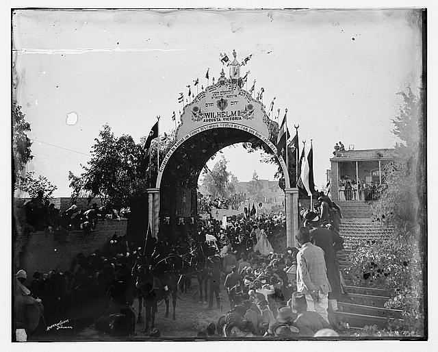 Emperor passing through the arch erected by the Jewish community of Jerusalem