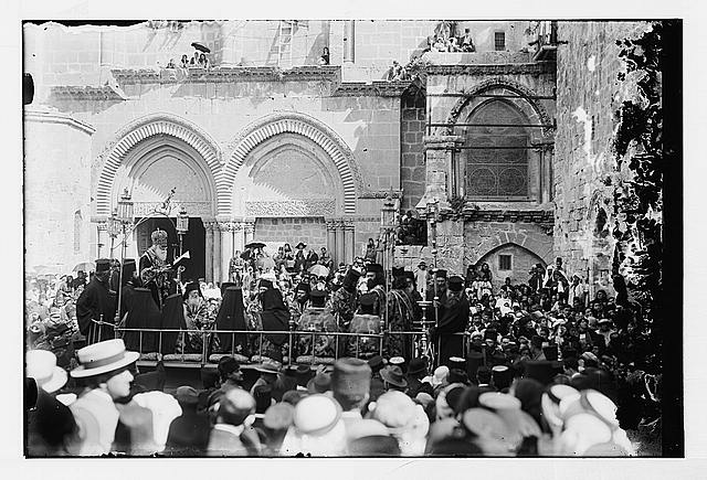 [Foot washing ceremony, possibly with Syrian Orthodox patriarch, outside the Church of the Holy Sepulchre, Jerusalem]