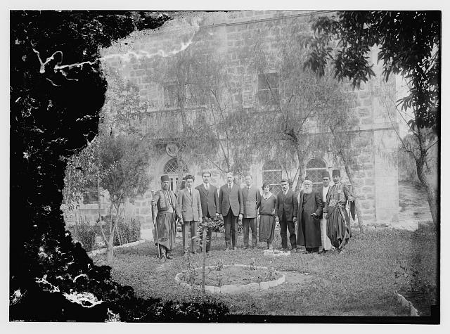 Group in front of consulate. Heiser [i.e., Oscar S. Heizer], American Consul, fourth from left