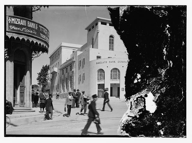 Street scene showing Barclay's & Mizrah bank buildings