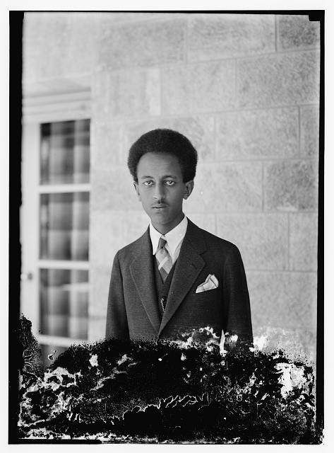 Son of H.S. [i.e., Haile Selassie] in suit & tie