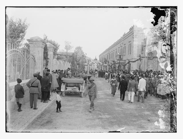 [Crowds in street, near archway, Jerusalem?]