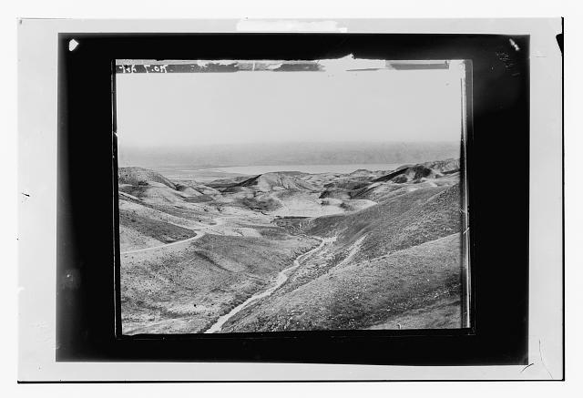 [Bird's-eye view of hills and body of water, possibly the Dead Sea]