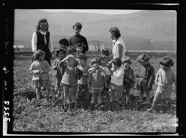 "The Keren Hayesod. Agricultural Colonies on Plain of Esdraelon ""The Emek."" Zionist children at play. A spring group. Children picking wild flowers"