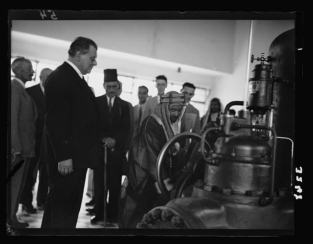 Opening ceremony of the P.E.C. [i.e., Palestine Electric Corporation] Jordan plant. H.H.Emir Abdullah starting turbines