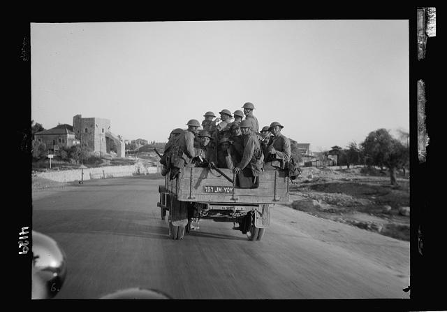 Palestine events. The 1929 riots, August 23 to 31. British troops patrolling highway. Open lorry loaded with steel helmeted troops