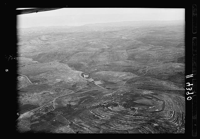 Air views of Palestine. Bethlehem and surroundings. Solomon's Pools looking E. with Hebron Road in foreground, wilderness & Mts. of Moab in distance