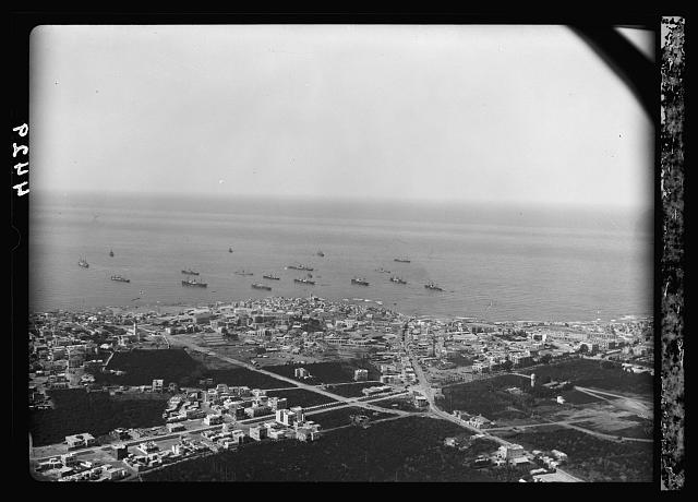 Air views of Palestine. Jaffa, Auji River and Levant Fair. Jaffa from the land side showing main roads into town. Orange ships at anchor