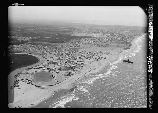 Air views of Palestine. Jaffa, Auji River and Levant Fair. Jewish stadium and the Levant Fair blds [i.e., buildings] looking S. toward Tel Aviv