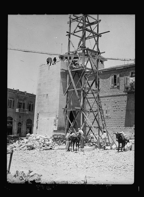 Taking down clock tower. Old P.O. square [Jerusalem?]