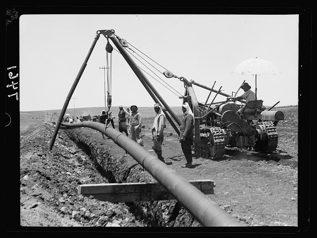 I.P.C. [i.e., Iraq Petroleum Company]. Dropping of pipe into trench & curving. Esdraelon