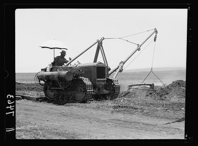 I.P.C. [i.e., Iraq Petroleum Company]. Tractor covering pipe in trench. Esdraelon