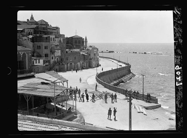 Palestine disturbances 1936. Jaffa. New street on sea front barricaded with barbed wire & troops
