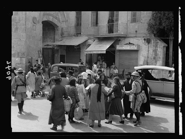 Palestine disturbances 1936. Jewish families conducted by British police, out of the Old City