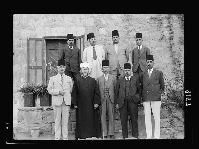 Palestine disturbances 1936. Members of the Arab Higher Committee. Front row from left to right: Ragheb Bey Nashashibi, chairman of the Defence Party, Haj Amin eff. el-Husseini, Grand Mufti & president of the Committee, Ahmed Hilmi Pasha, Gen. Manager of the Jerusalem Arab Bank, Abdul Latif Bey Es-Salah, chairman of the Arab National Party, Mr. Alfred Roke, influential land-owner