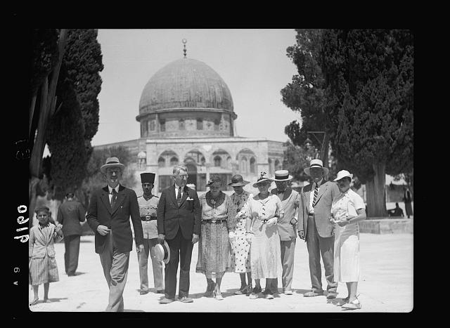 Palestine disturbances 1936. The Delegation of American senators and their wives visiting the Temple Area in Jerusalem. The party is here seen leaving the Dome of the Rock, seen in the background, on their way to visit Mosque el-Aksa [i.e., al-Aqsa]