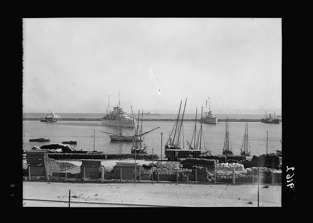 Palestine disturbances 1936. Haifa harbour, The S.S. Laurentic which carried the troops, is seen in the distance, cruisers in harbour