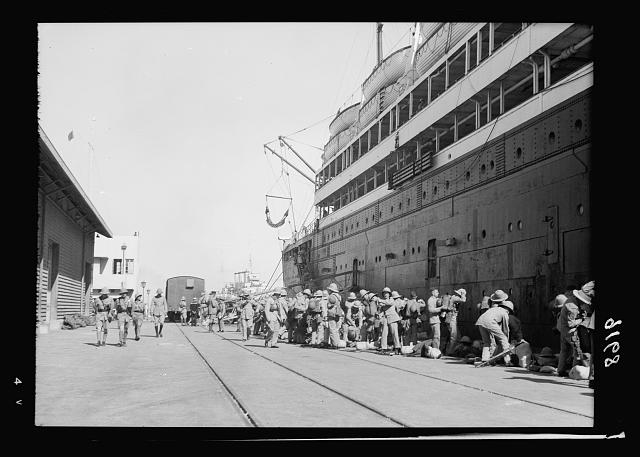 Palestine disturbances 1936. General view of the troops on the Haifa quay after disembarking from the Laurentic which looms up in the picture on the right