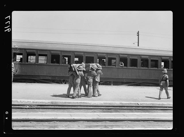 Palestine disturbances 1936. Remains of Lt. Cpl. Merry of the Yorks & Lancs, being placed on train to be taken to Sarafand for burial