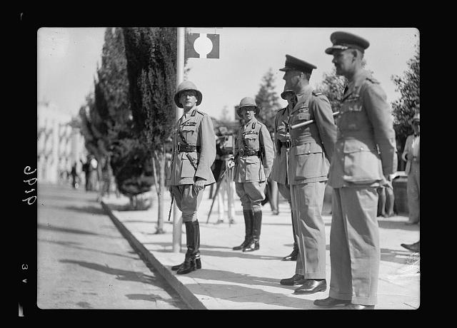 Palestine disturbances 1936. Lt. General Dill awaiting the parade of the Scots Guards before King David Hotel. In middle background, Major General Armetage to right Air Vice Marshal Pierce and air Commadore Hill