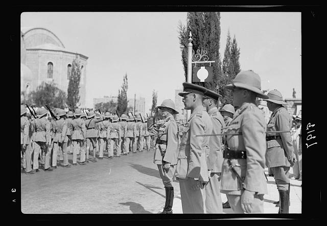 Palestine disturbances 1936. Lt. General Dill taking the salute as the Scots Guards parade passes down the Julian Way between the King David Hotel and the Y.M.C.A. building