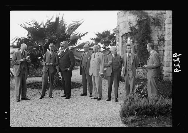 Palestine disturbances, 1936. Group of the members of the Royal Commission photographed in the garden of the King David Hotel immediately after their first official sitting when H.E. the High Commissioner was the first witness brought before them