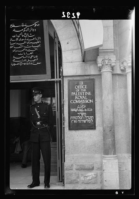 Palestine disturbances 1936. Outside entrance of the Office of the Palestine Royal Commission with a British Palestine Police standing on duty