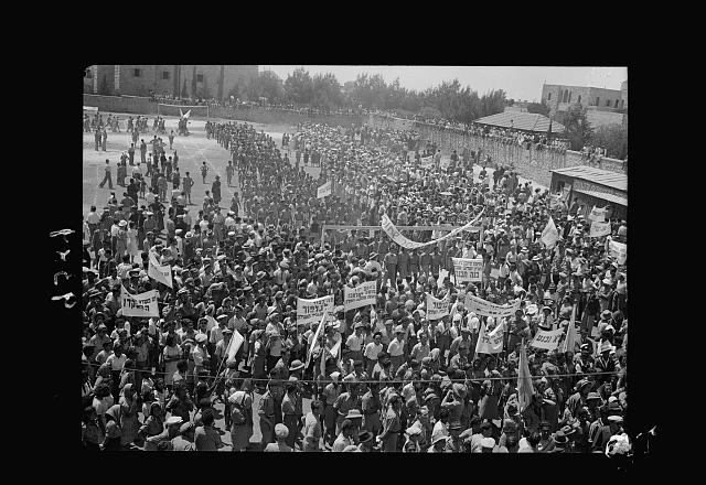 Jewish protest demonstrations against Palestine White Paper, May 18, 1939. Mass gathering of various demonstrating groups at the Rehovia [i.e., Rehavia] gymnasium [Jerusalem]