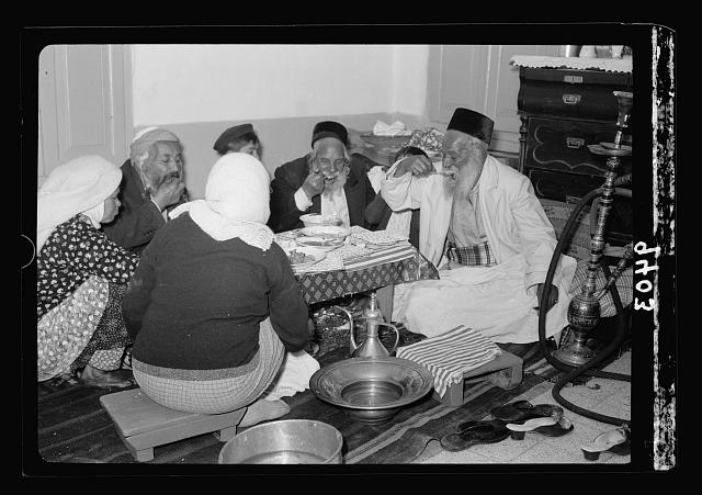 Ceremony of eating the Passover, Yemenite family, April 3, 1939. Eating regular meal