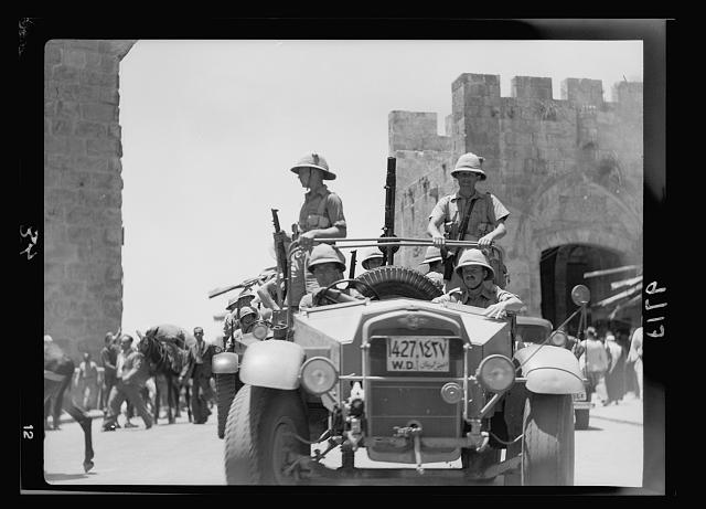 Result of terrorist acts & government measures. Military raid for arms on Jaffa Gate section, July 13, '38, showing army cars with machine guns