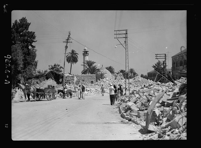 Jenin, Sept. 3, 1938. The main Jerusalem Galilee highway running through Jenin with piles of debris caused by dynamiting